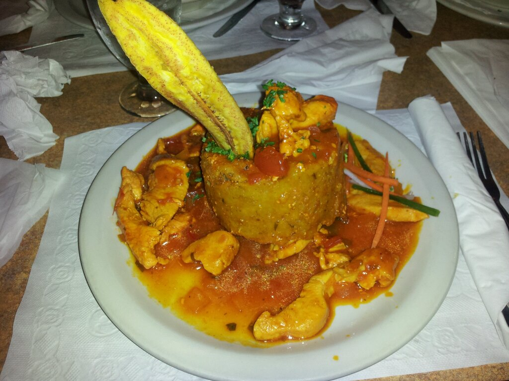 Mofongo with chicken in a tomato based sauce.  Photo courtesy of Elizabeth Maldonado