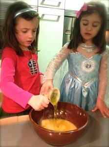 Cooking with a friend teaches kids valuable lessons about patience, taking turns and teamwork.