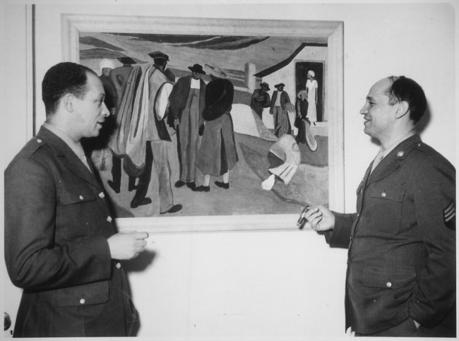 Romare Bearden with cousin in front of painting