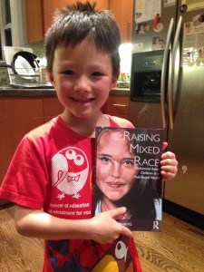 Raising Mixed Race holding book