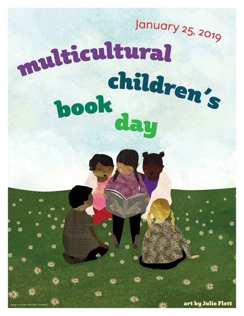 multicultural children reading a book