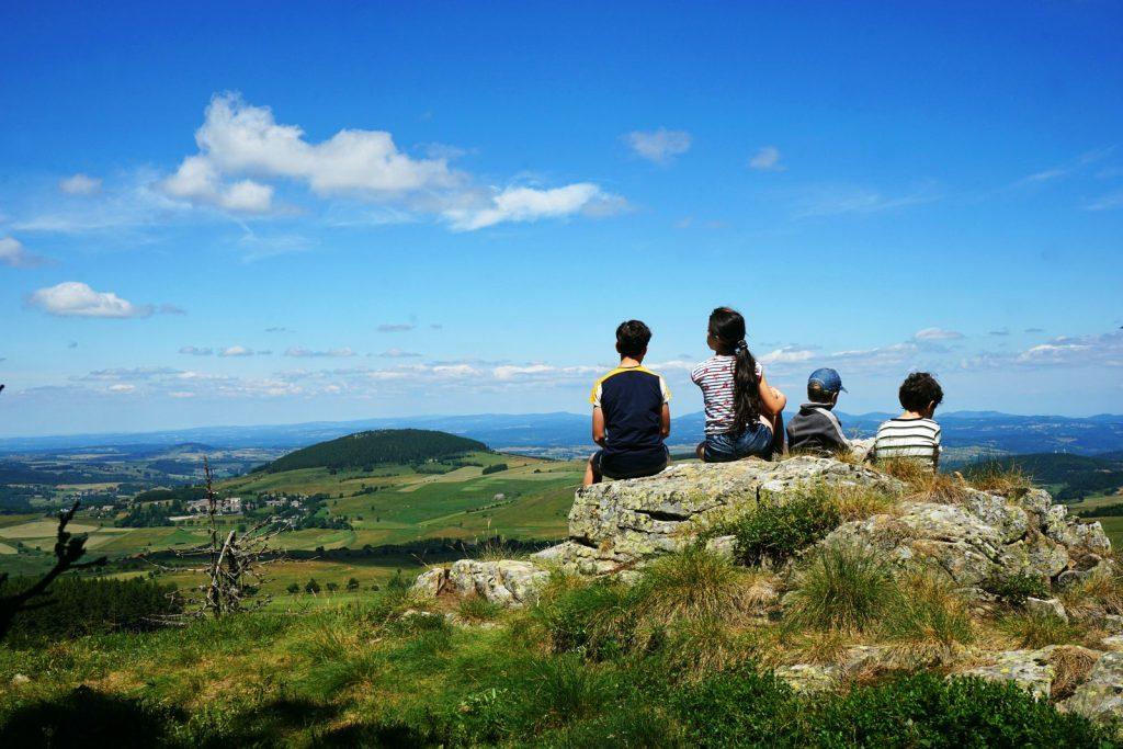 Children sitting on a rock | MKB