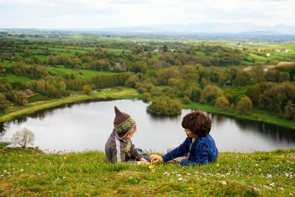 Playing on a hill above a lake | | Let Children Fall in love with Earth | MKB