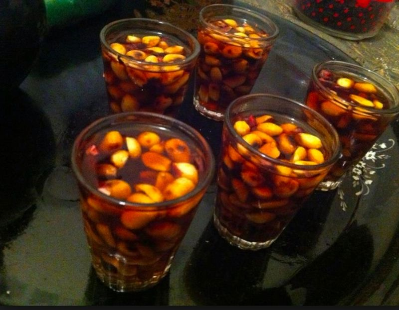 Cups of tea with peanuts floating in them