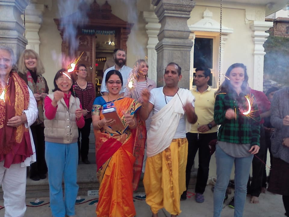 People celebrating Diwali with sparklers