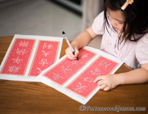 girl practicing chinese lettering