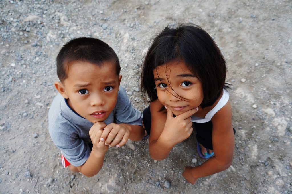 Photo of two kids looking up while figuring out how what to do