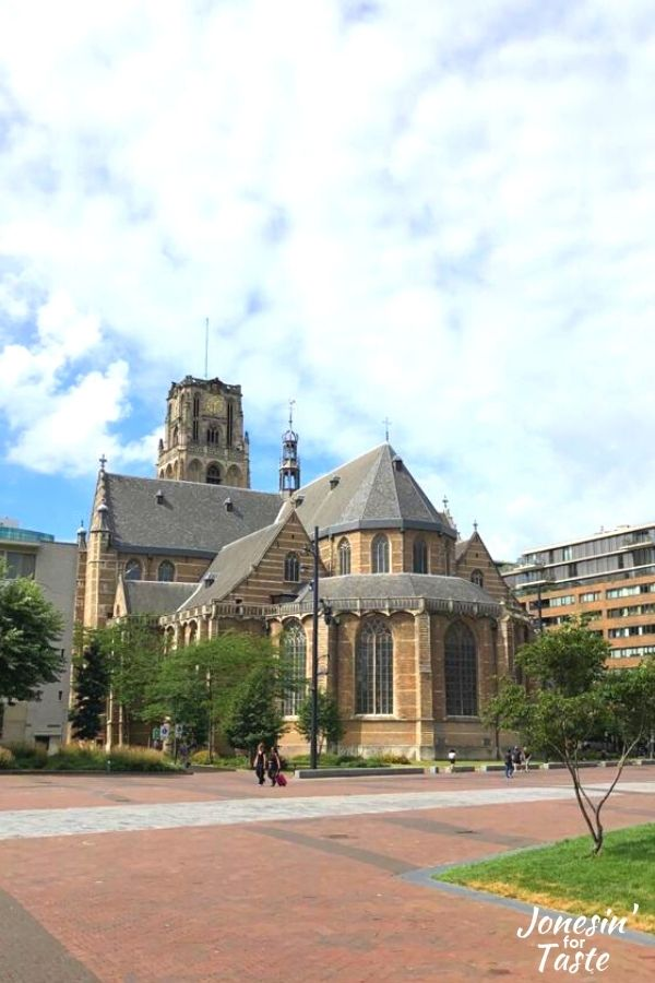 the Laurenskerk in downtown Rotterdam on a sunny day with fluffy white clouds in the sky