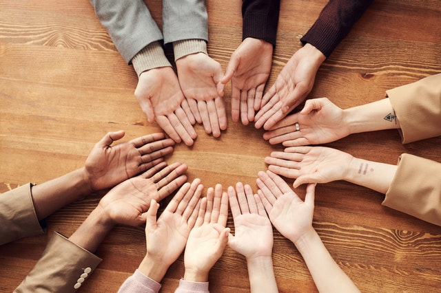 A circle of hands with different skins colors | Do we need to be talking to kids about skin color? | Multicultural Kid Blogs