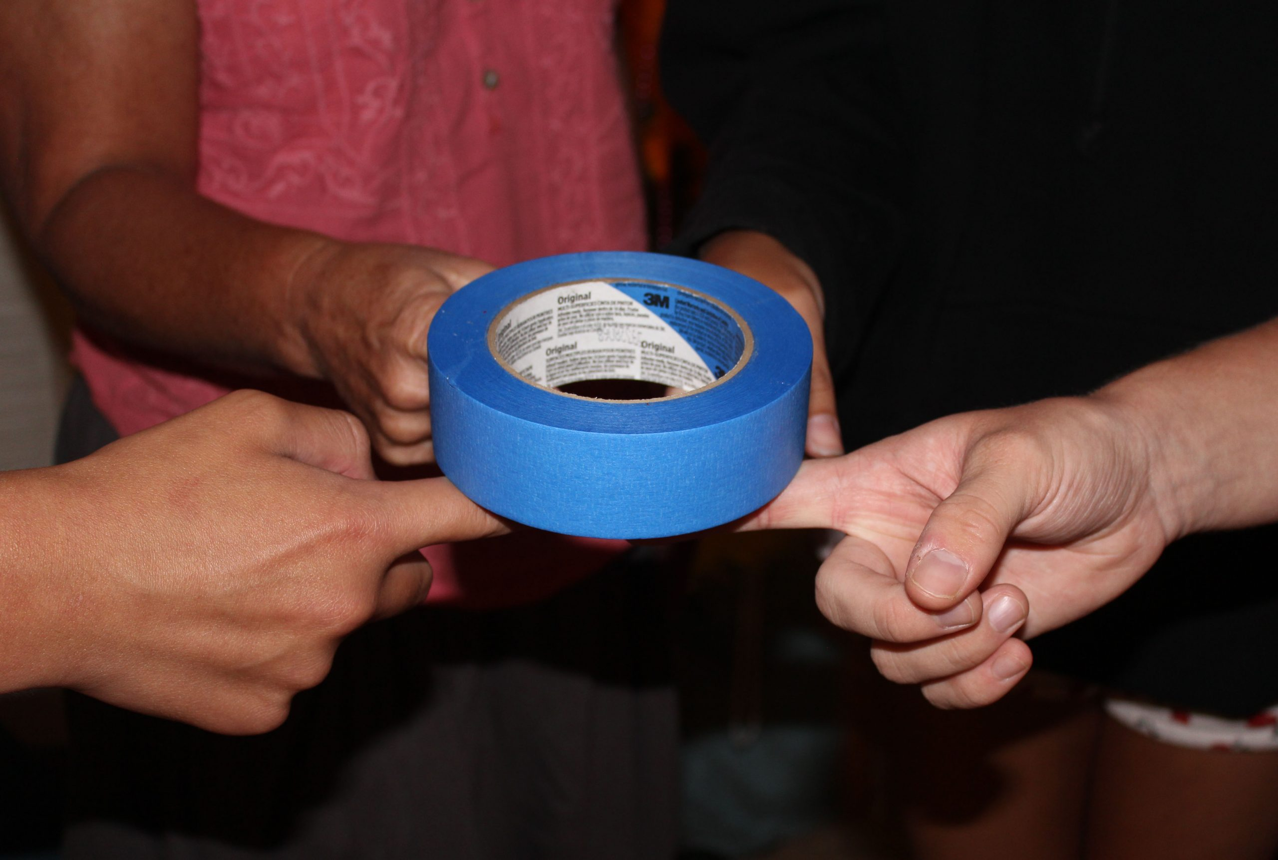 Players holding the roll of tape with their fingers