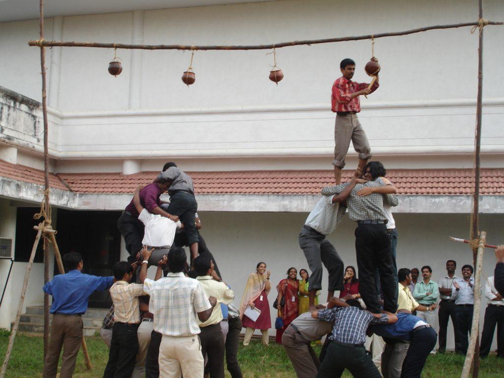 Human Pyramid Made to Collect a Pot Hanging Up High