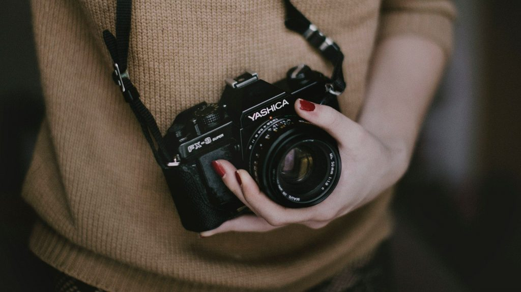 photography holding a camera